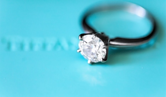 A simple yet well-made diamond ring with a large stone in the center.