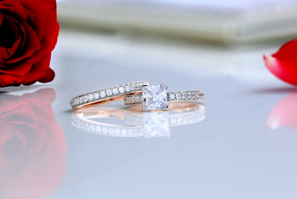 Two Diamond-Studded Bands, with A Princess-Cut Stone on One of Them